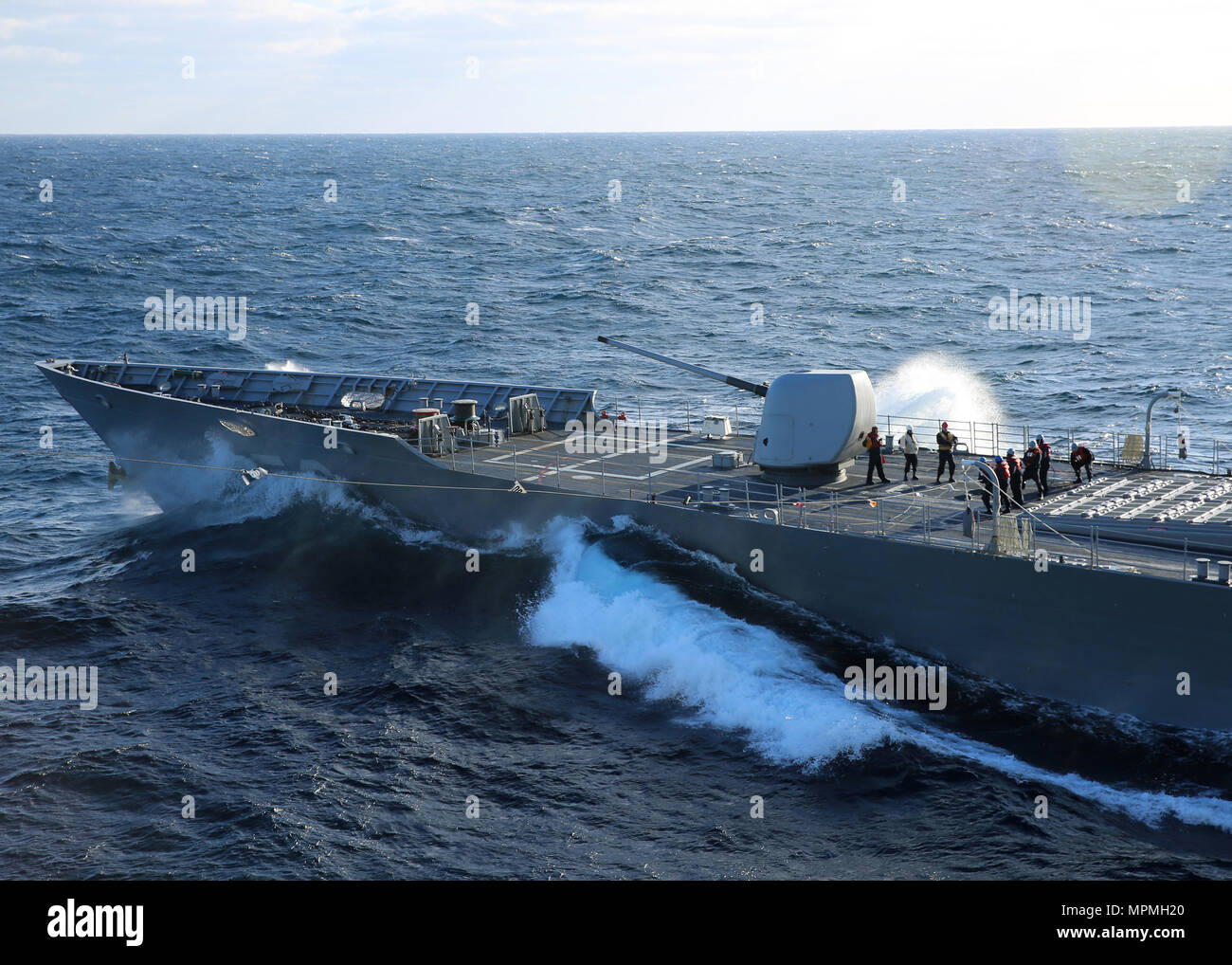 170323-N-OH262-780  ATLANTIC OCEAN (March 23, 2017) U.S. Navy Sailors assigned to the Ticonderoga-class guided-missile crusier USS San Jacinto (CG 56) man the phone and distance line during a replenishment-at-sea with the Military Sealift Command fast combat support ship USNS Arctic (T-AOE 8). (U.S. Navy photo by Bill Mesta/Released) - Stock Image