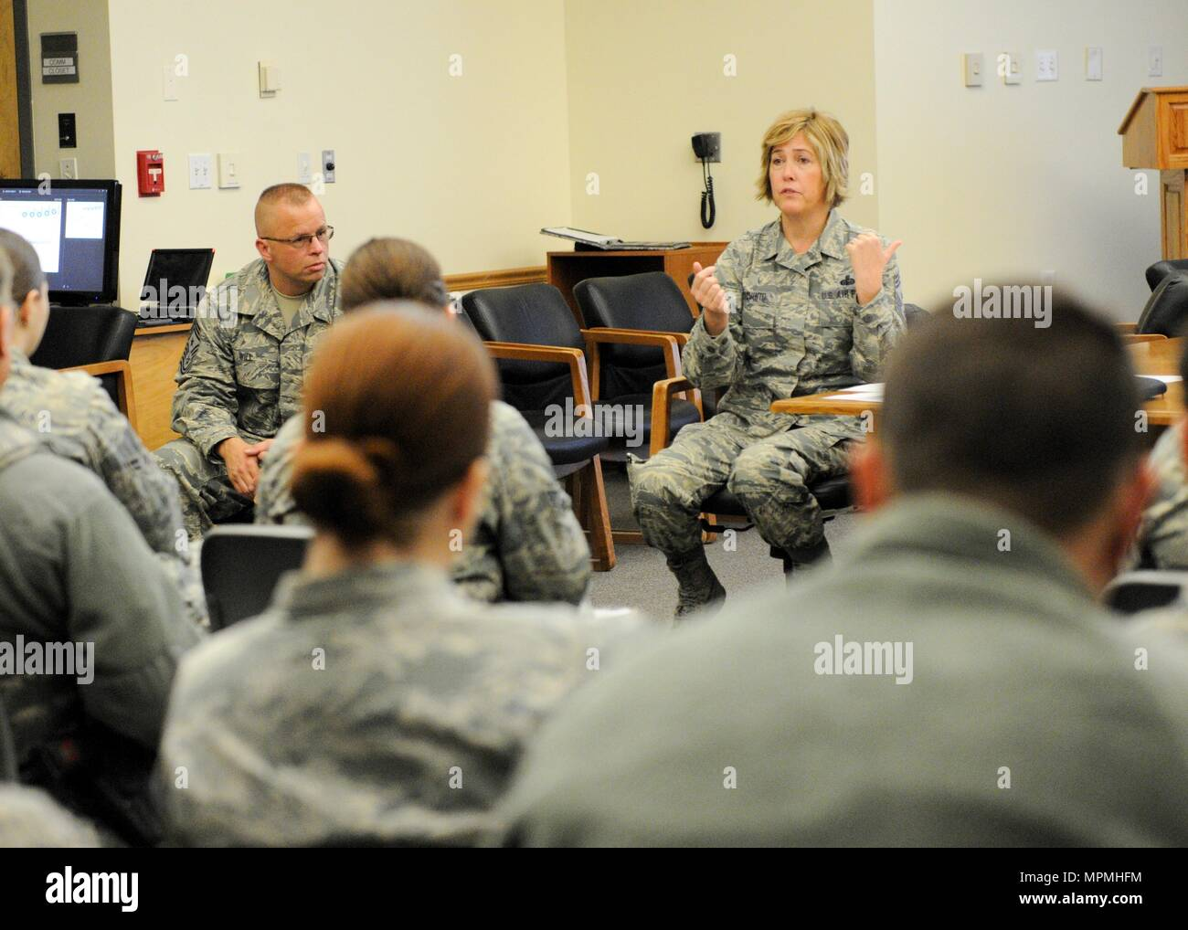 Chief Master Sergeant Amy R. Giaquinto, Air National Guard Command Chief for New York visits the 174th attack wing enlisted council meeting at Hancock field in Syracuse NY on April 1, 2017.  Giaquinto spoke to the structure and importance of the Enlisted Performance Review (EPR) as it applies to the members of the Air National Guard. (NY Air National Guard photo by Master Sgt. Lillique Ford/released) - Stock Image