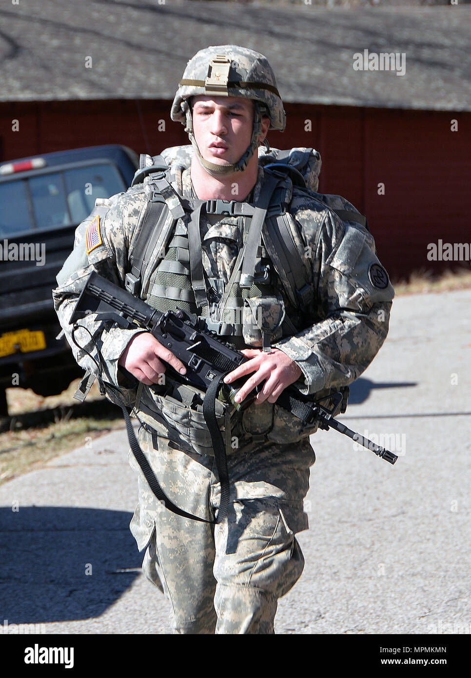 U.S. Army Sgt. Mitchell Cooper, Co. D, 2nd Battalion 108th Infantry completes a grueling 12-mile forced march to complete the New York Army National Guard Best Warrior Competition at Camp Smith Training Site April 2, 2017. The Best Warrior competitors represent each of New York's brigades after winning competitions at the company, battalion, and brigade levels. At the state level they are tested on their physical fitness, military knowledge, endurance, marksmanship, and land navigation skills. Cooper won the Soldier of the Year will advance to compete at the regional level later this year. (U. - Stock Image