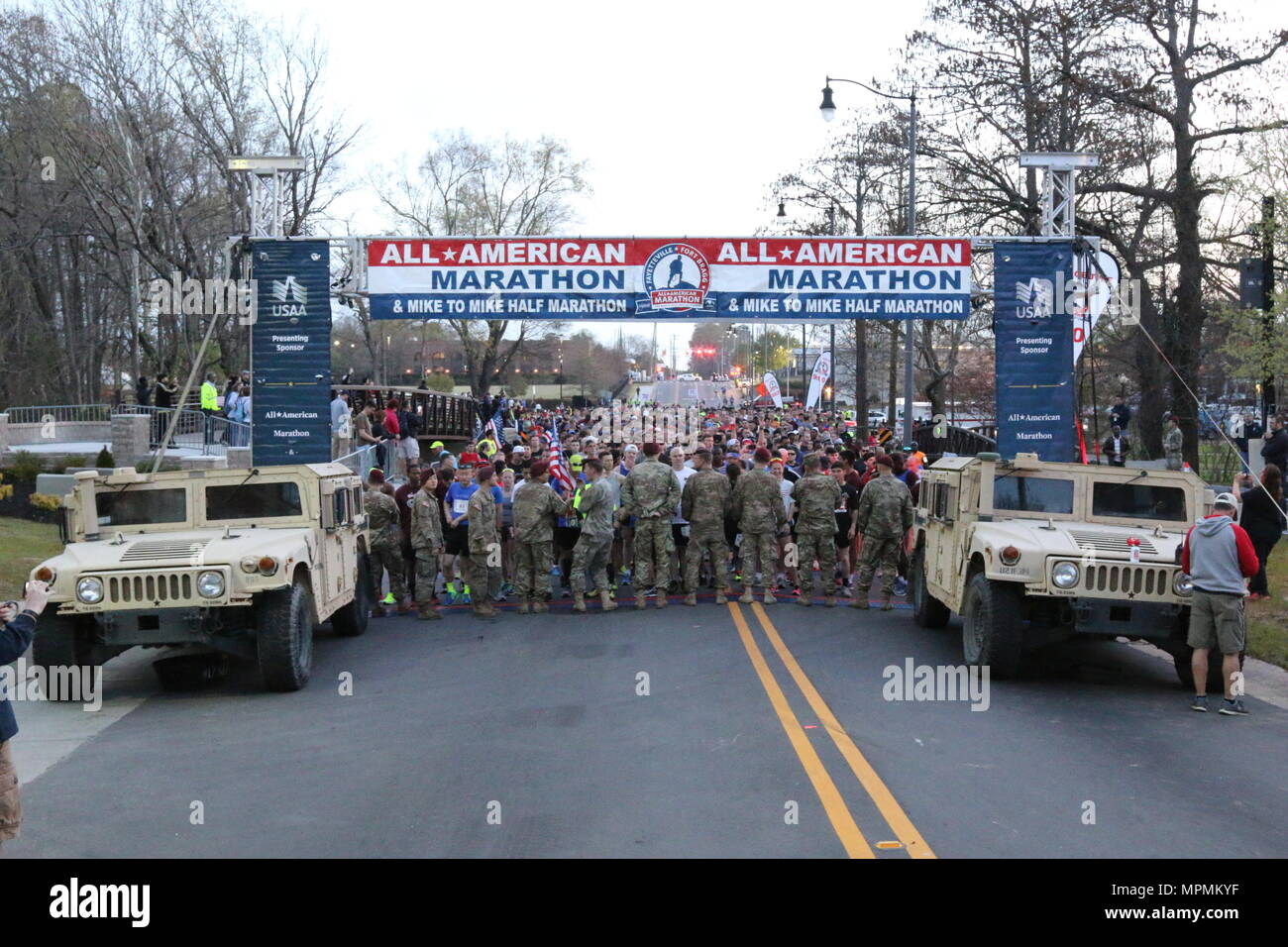 A collection of registrants wait to begin the All American Marathon Mar. 26, 2017 in Fayetteville, N.C. The marathon started at Fayetteville's Festival Park and allowed the event goers an opportunity to run through the center of the historic portion of the city, passing the Airborne and Special Operations Museum. (U.S. Army photo by Pfc. Hubert D. Delany III/22nd Mobile Public Affairs Detachment) Stock Photo