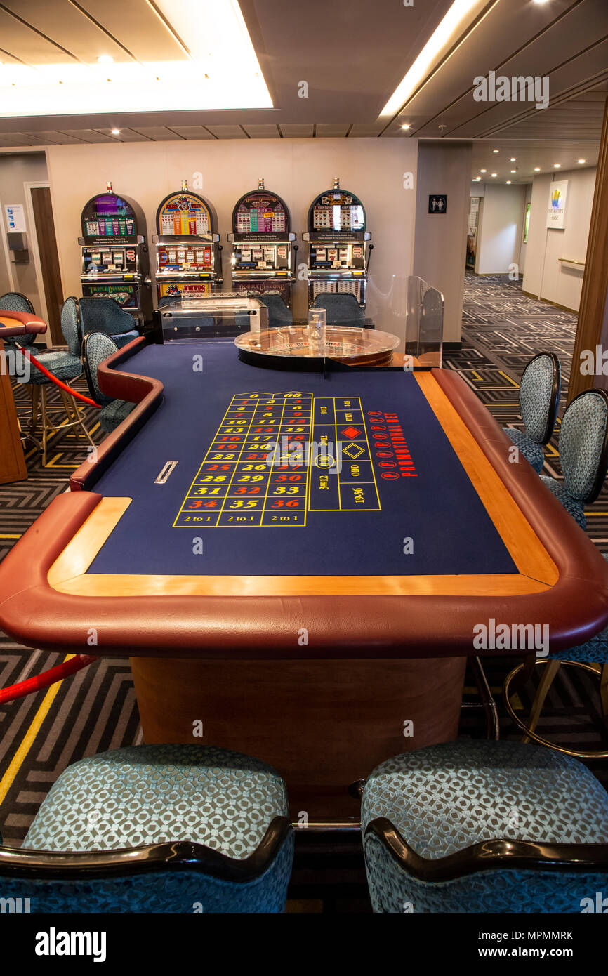 Roulette table on a cruise ship waiting for punters to place bets - Stock Image