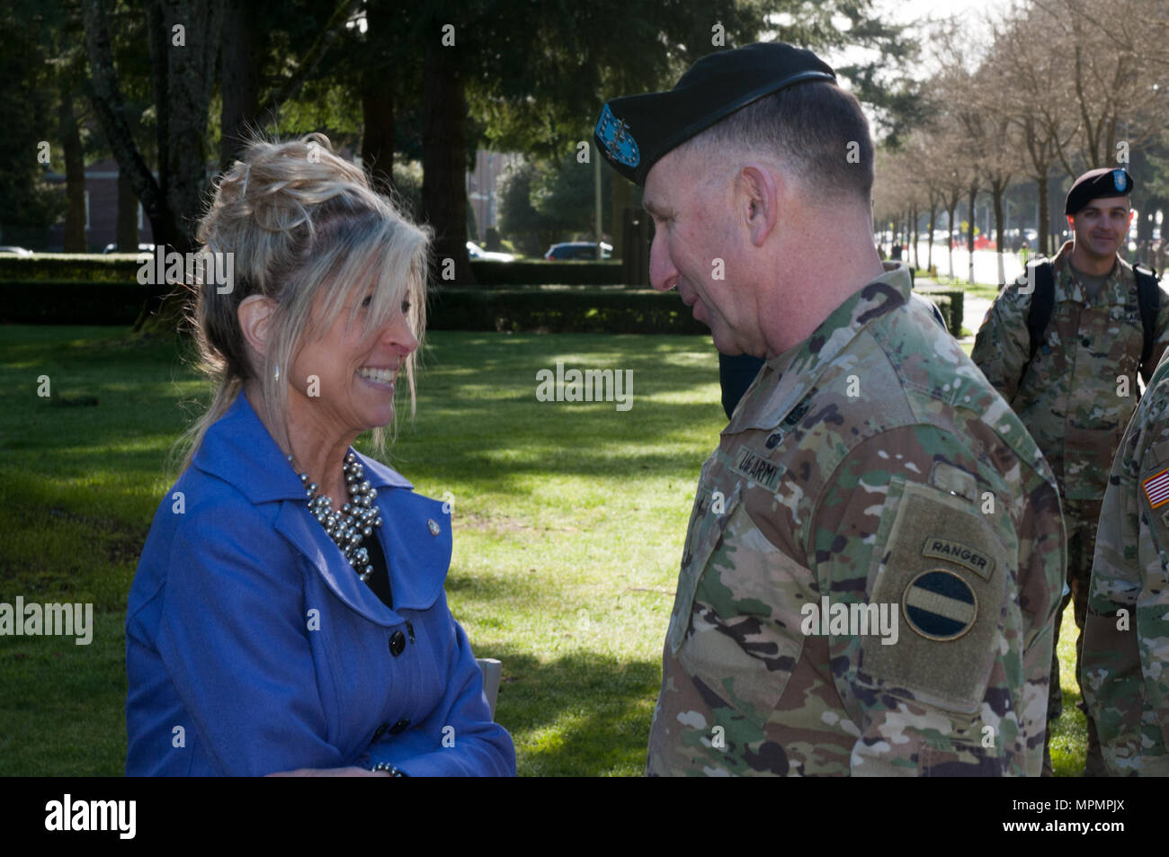 Madeline Lanza (left), an advocate for better schooling for military children and wife of Lt. Gen. Stephen R. Lanza, Commanding General of I Corps, greets U.S. Army Forces Command Commanding General Gen. Robert B. Abrams (right) prior to I Corps' Change of Command on Joint Base Lewis-McChord, Washington, Apr. 3. Mrs. Lanza is a large supporter of military life and what it entails for the spouses and children. (U.S. Army photo by Sgt. David N. Beckstrom, 5th Mobile Public Affairs Detachment, I Corps)