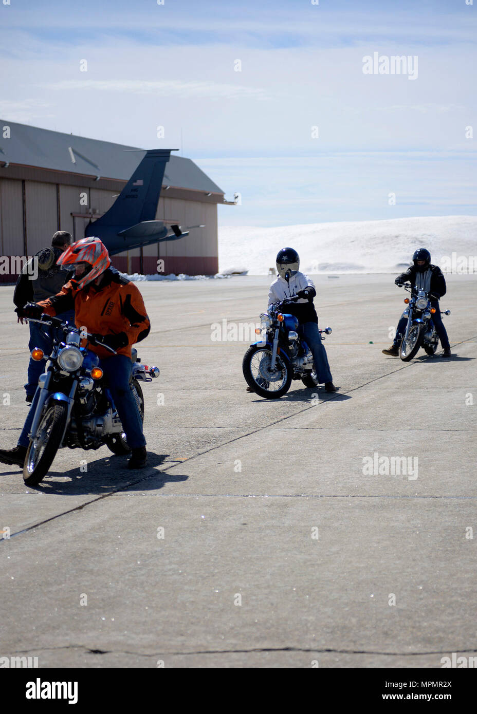 Students of a beginner motorcycle course learn how to park their bikes, Pease Air National Guard Base, N.H., April 3, 2017. (U.S. Air National Guard photo by Airman Victoria L. Nelson) - Stock Image