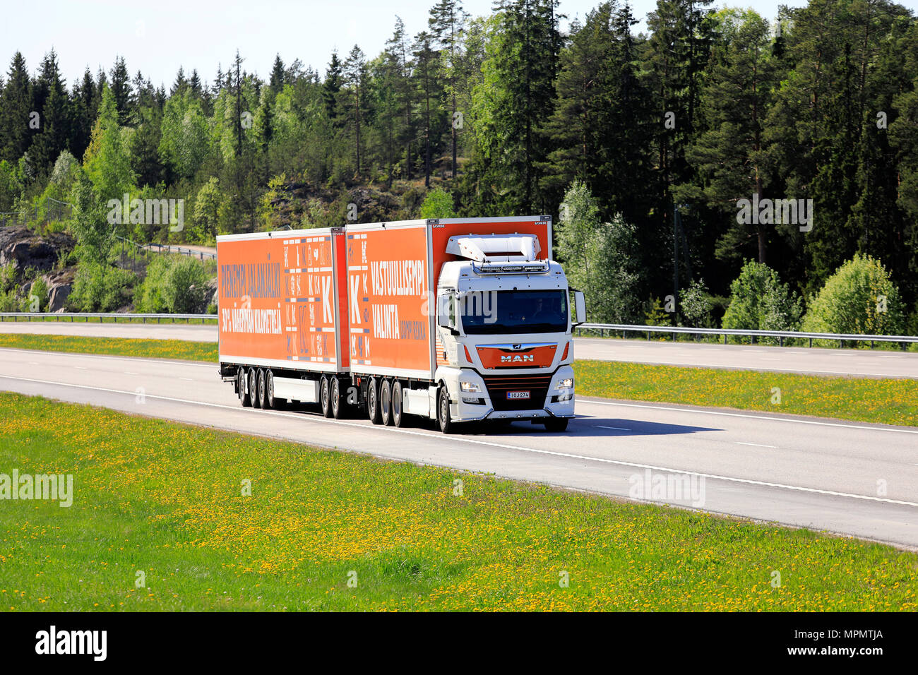 Man TGX 35.580 high capacity transport truck for Kesko Logistics. The 31,2m long 74tn road train operates by permission. Paimio, Finland - May 18, 18. - Stock Image