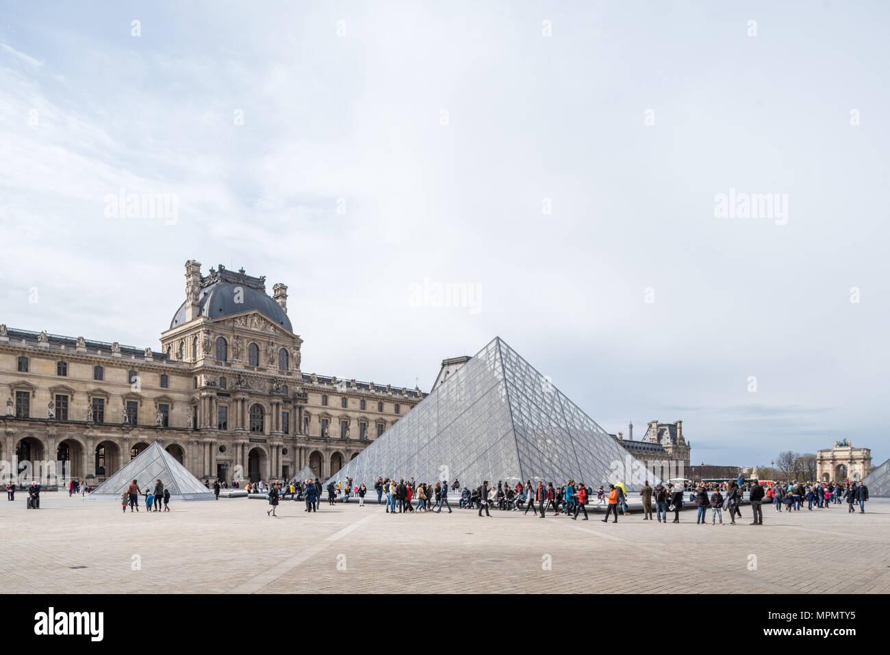 France, Paris - 2 April 2018: Pyramide du Louvre designed by I.M. Pei - Stock Image