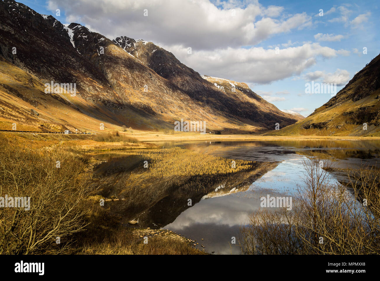 Loch Achtriochtan on a beautiful day reflecting in the water. - Stock Image