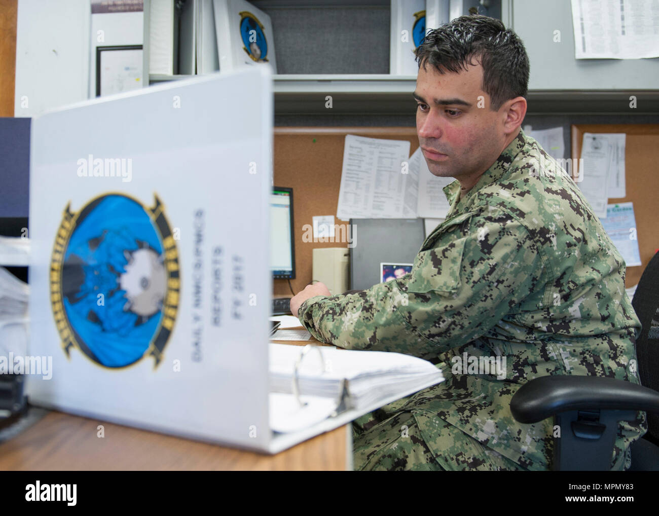PANAMA CITY, Florida - Logistics Specialist Second Class (AW) Michael Semler tracks helicopter parts on order while on duty at the Naval Surface Warfare Center Panama City Division Aviation Unit March 16, 2017. U.S. Navy Photo by Eddie Green (Released) 170316-N-UI581-019 Stock Photo