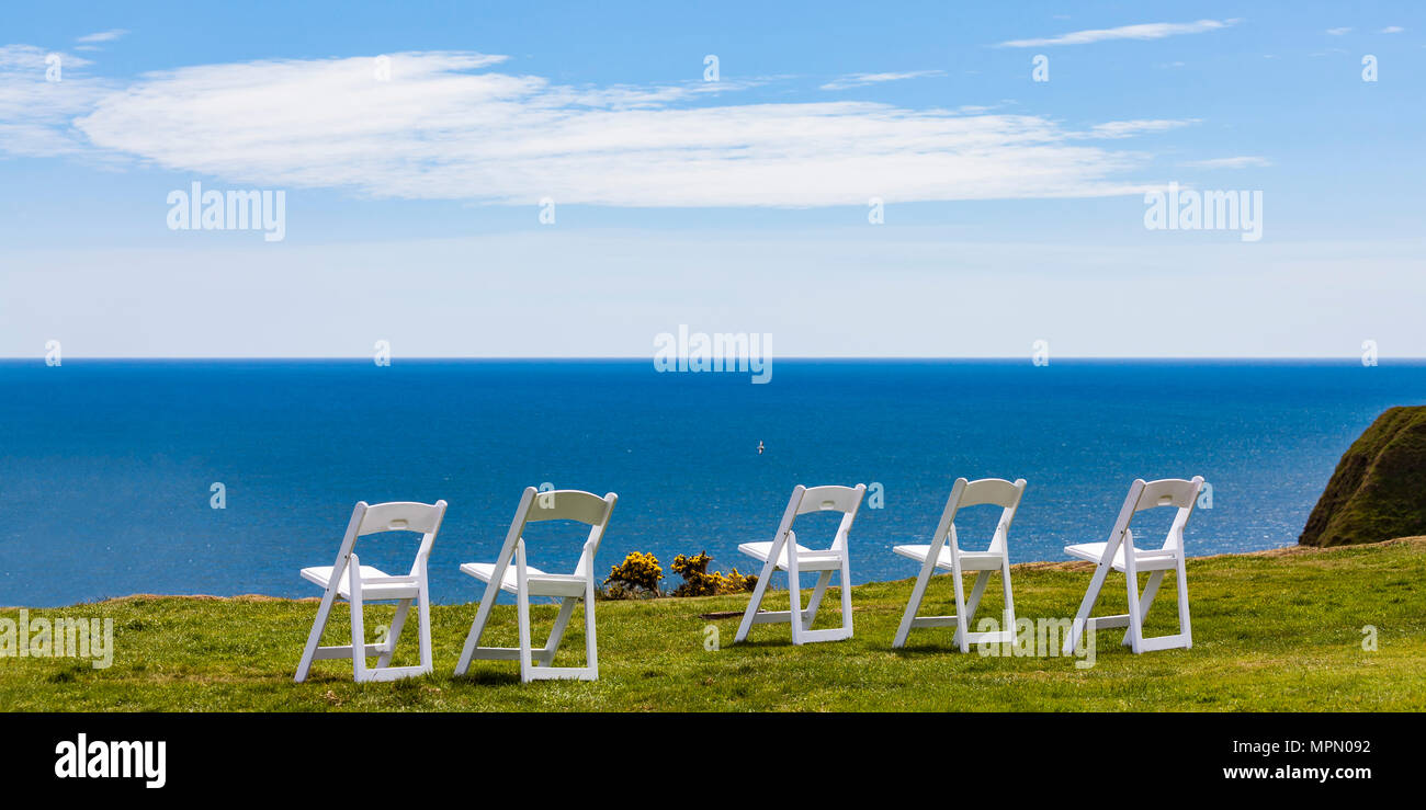 Scotland, Aberdeenshire, Empty chairs at the sea near Stonehaven - Stock Image