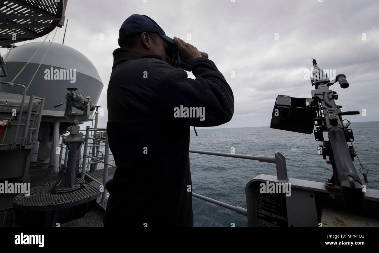 Seaman Luis Figuereo scans for contacts while on watch aboard USS Leyte Gulf (CG 55). Leyte Gulf is conducting naval operations in the U.S. 6th Fleet area of operations in support of U.S. national security interests in Europe. (U.S. Navy photo by Mass Communication Specialist 2nd Class Sonja Wickard/Released) Stock Photo