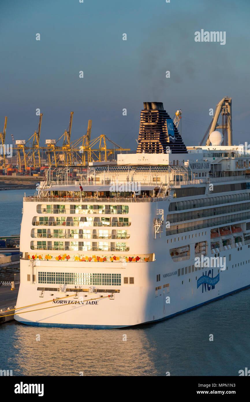 'Norwegian Jade' cruise ship and the dockyards at sunset, Livorno, Tuscany, Italy - Stock Image