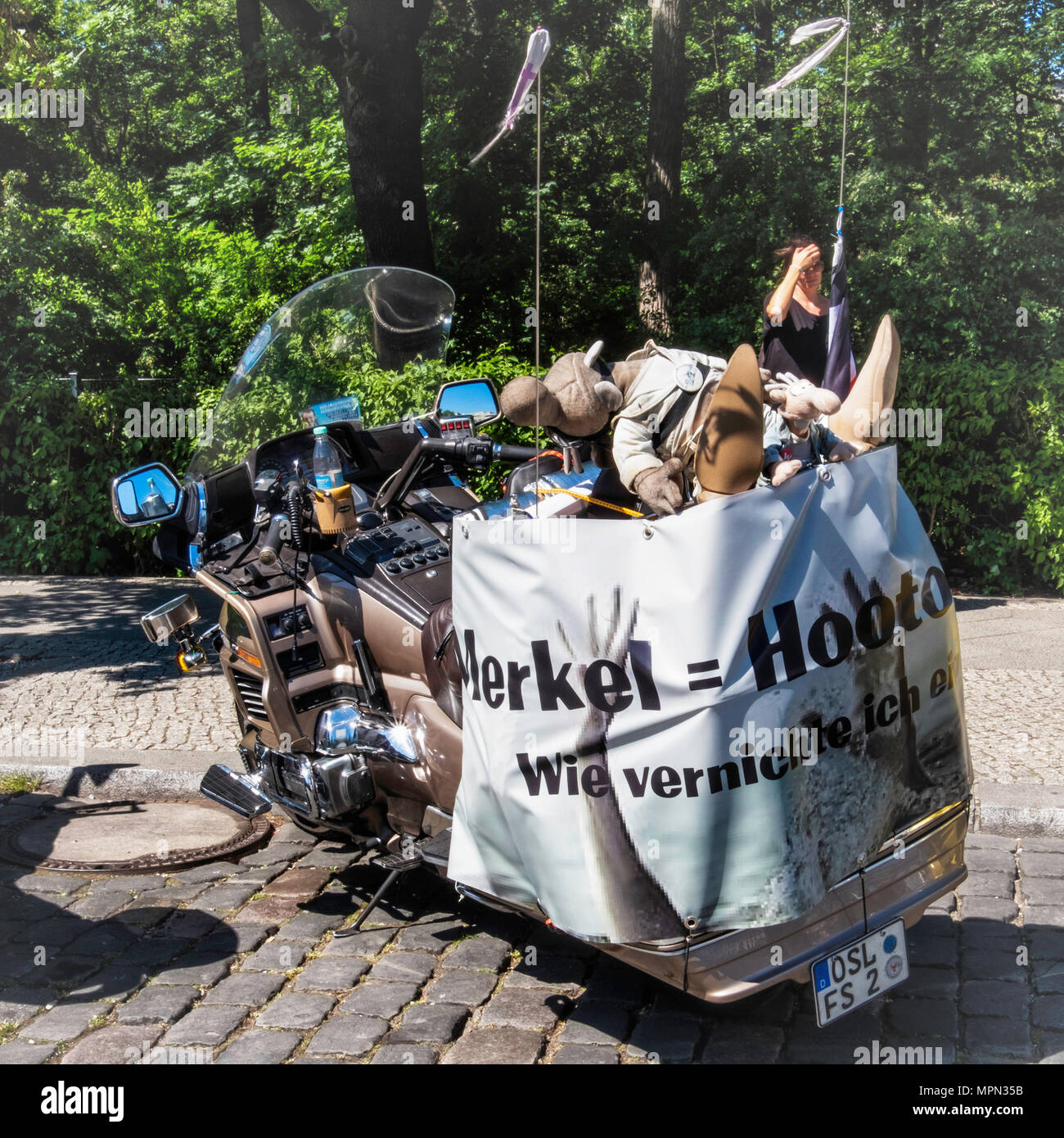 Berlin Mitte, Motor bike detail. Parked boke with protest poster and cuddly toy mascots at  Bikers Demo. - Stock Image