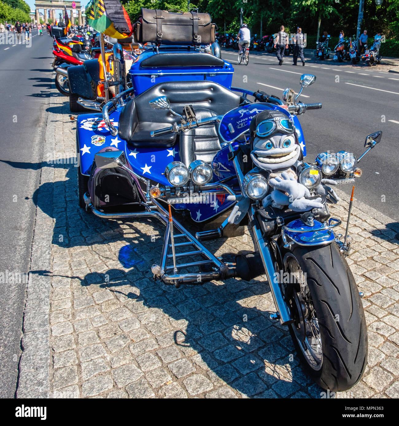 Berlin Mitte, Motor bike detail. Blue Parked bike mascot and  in aviators helmetl at Bikers Demo. - Stock Image