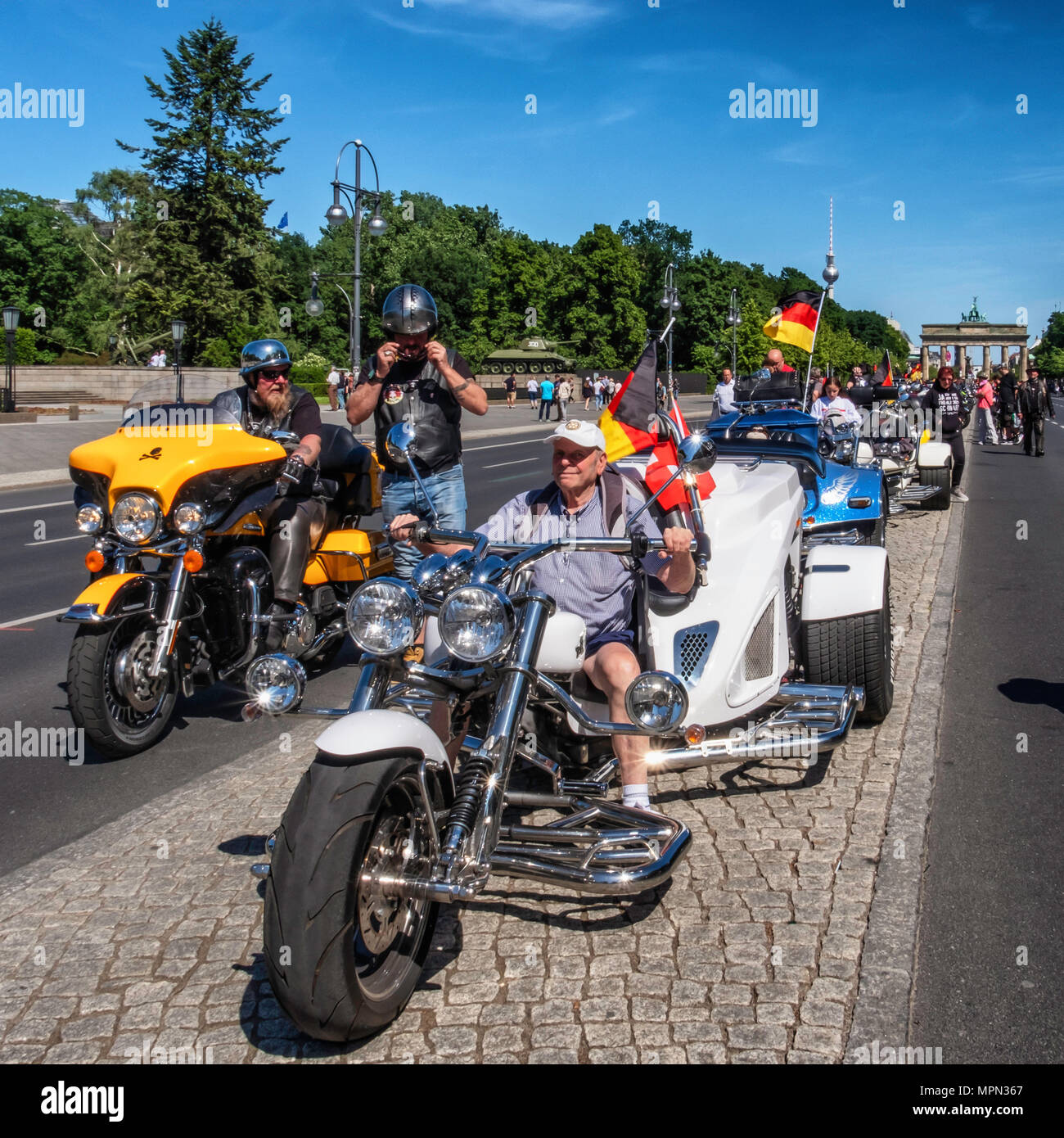 Berlin Mitte, Senior man tries three wheeler motor bike at Bikers for Germany demo. Hundreds of Bikers protest at the Brandenburg Gate for protection  - Stock Image