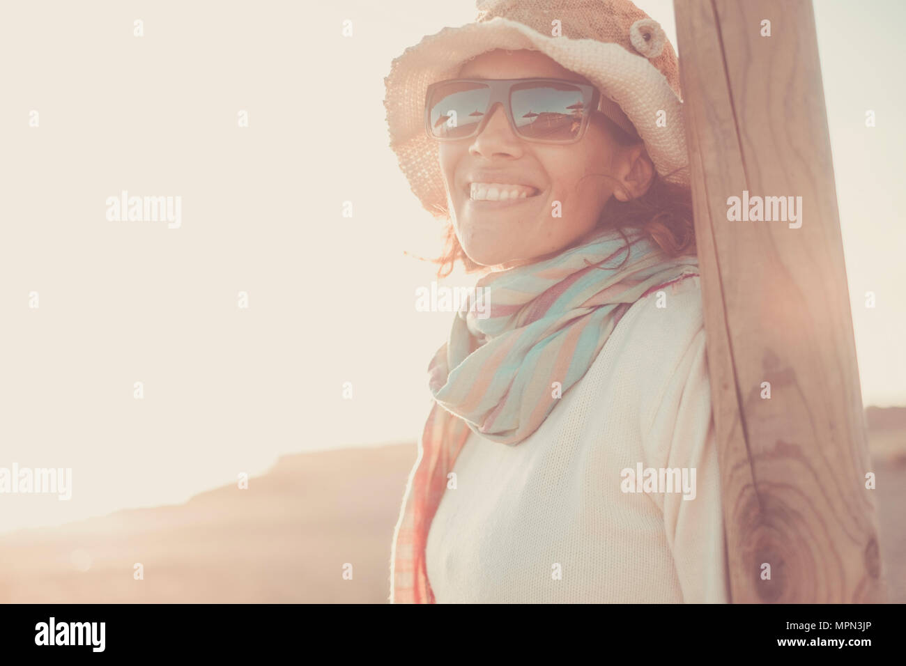 beautiful caucasian woman smile enjoying the outdoor lifestyle with a sunny day in tenerife. sun on her cute face wearing sunglasses. travel and vacat Stock Photo