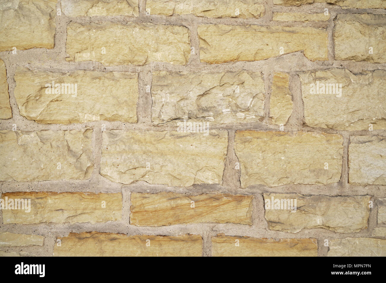 natural stone wall masonry background texture pattern - Stock Image