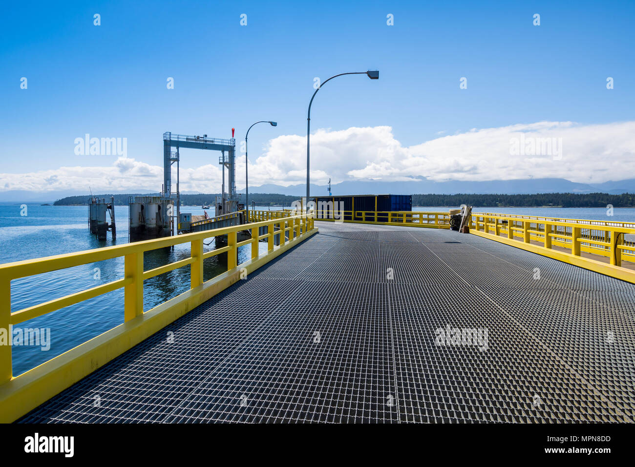Approach ramp for cars onto ferry boat - Denman Island cable ferry - BC, Canada. - Stock Image