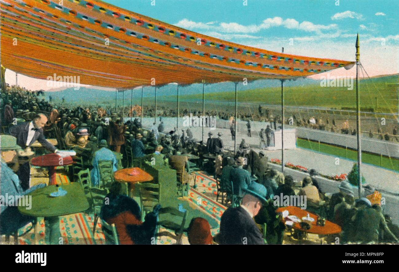 'Watching the Races in front of Club House, Agua Caliente Jockey Club', c1939. Artist: Unknown. - Stock Image