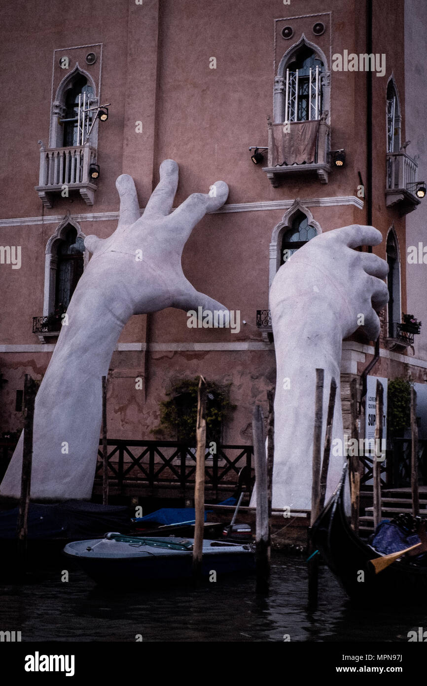 Hands in venice - Stock Image