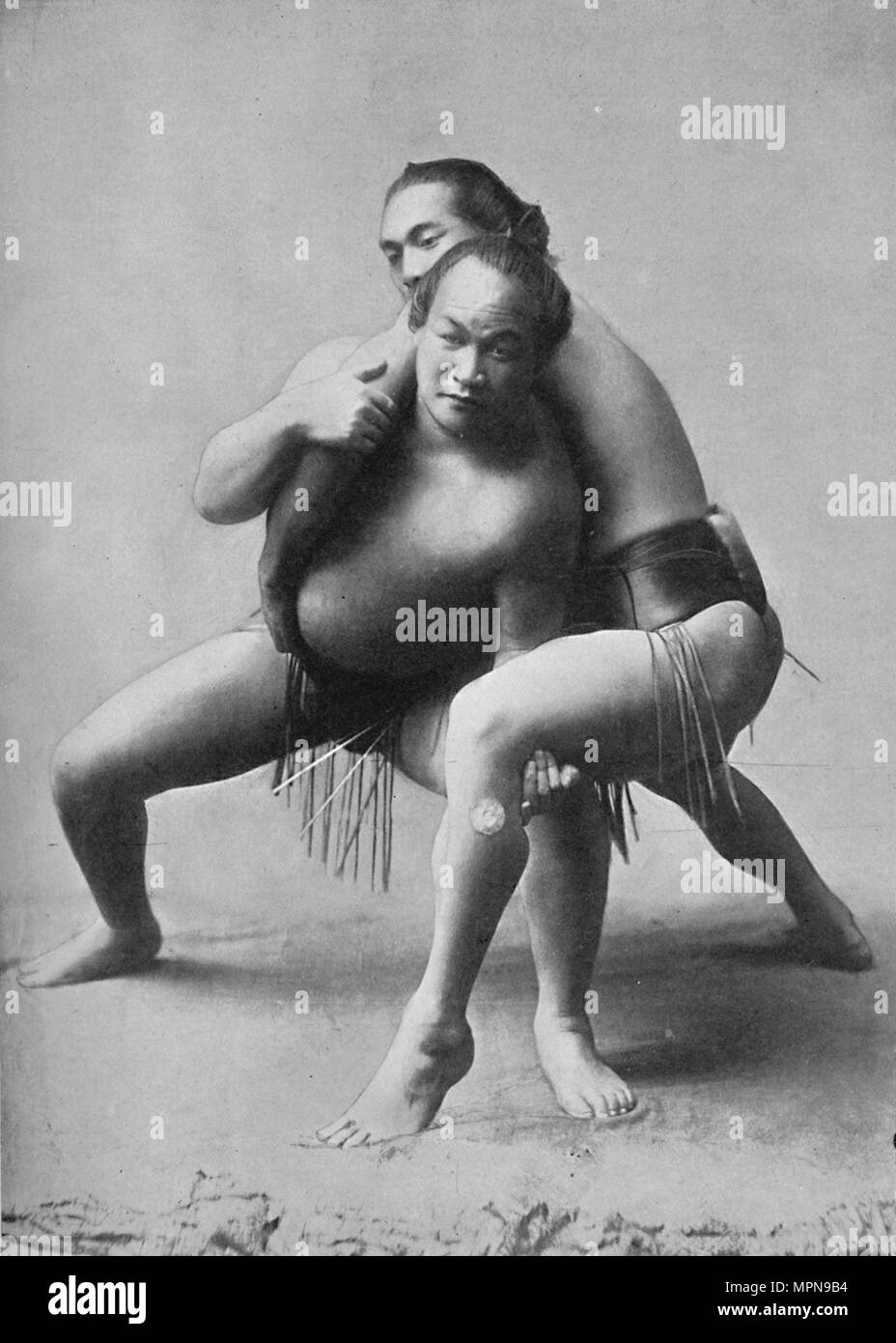 A sumo wrestling bout between a pair of Japanese professionals, 1902. Artist: Unknown. - Stock Image