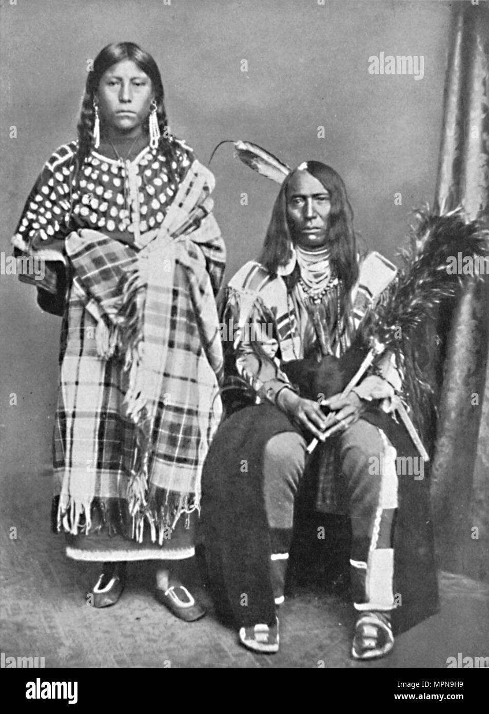 A Sioux chief and his squaw, 1912. Artist: Robert Wilson Shufeldt. - Stock Image