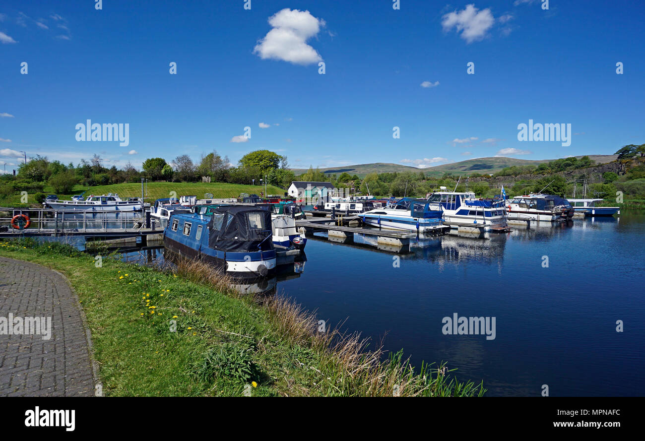 Boats moored in the basin on the Forth and Clyde Canal at village Auchinstarry near Kilsyth North Lanarkshire Scotland UK - Stock Image