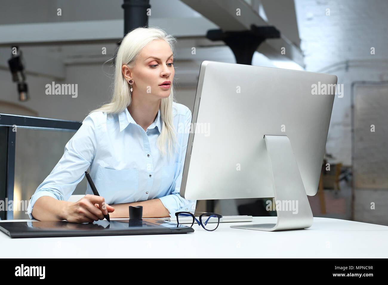 Interior decorator. The designer designs on a computer. - Stock Image