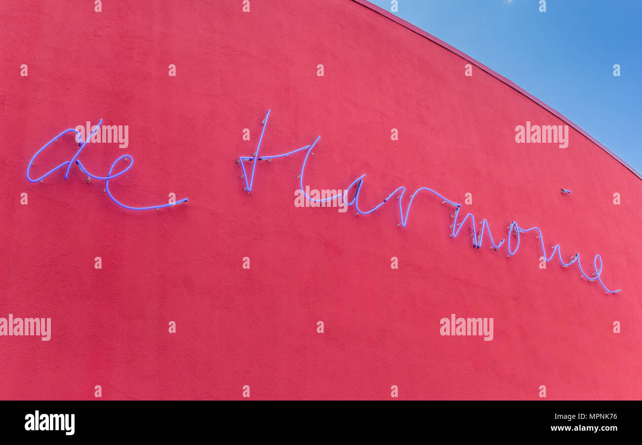 Theater name Harmonie on the red facade in Leeuwarden, Netherlands - Stock Image