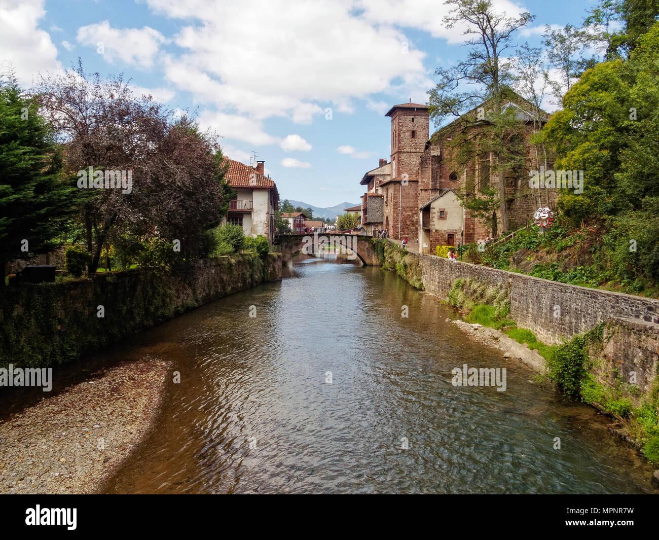 Nive River, the St James Bridge and the Church of Notre-Dame du Bout du Pont - St Jean Pied de Port, France - Stock Image