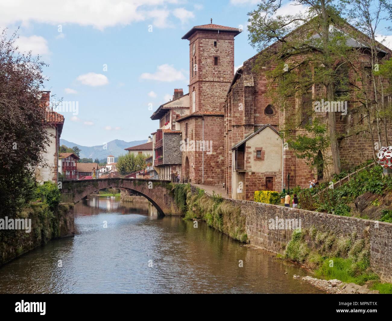 Nive River, the St James Bridge and the Church of Notre-Dame du Bout du Pont - Saint Jean Pied de Port, France - Stock Image