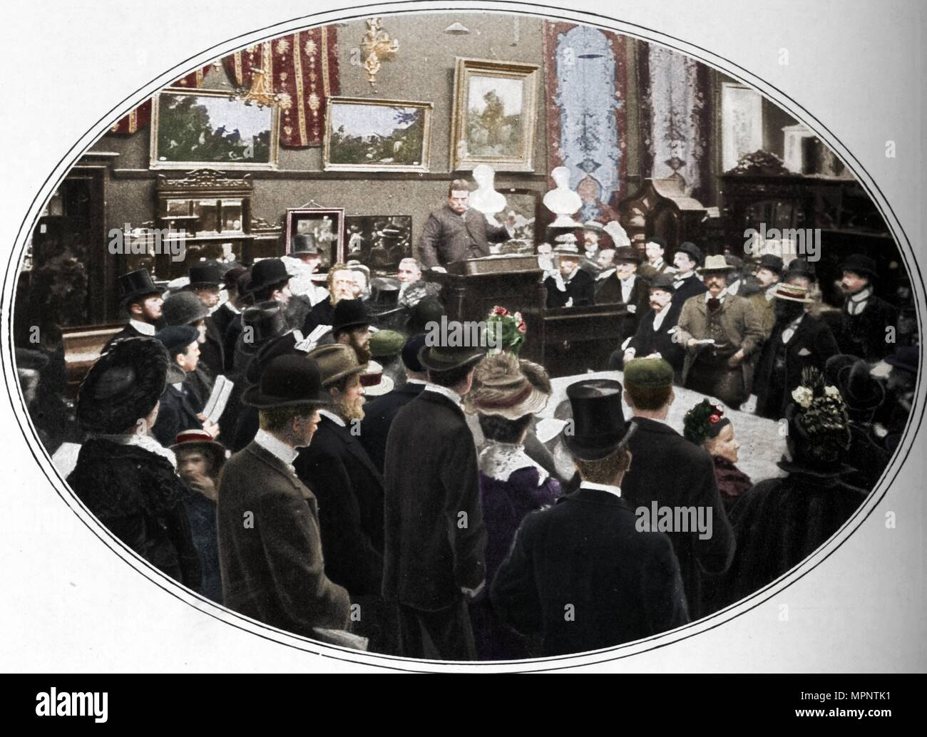 Auction in progress at Phillips auctioneers, London, c1901 (1901). Artist: Unknown. - Stock Image