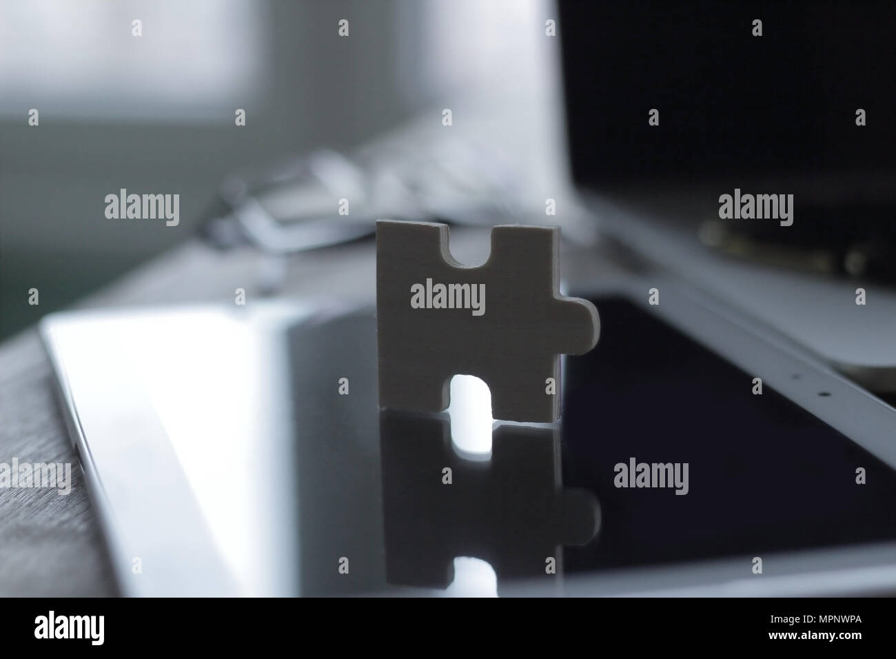 close up.puzzle piece on a blurred background desktop - Stock Image