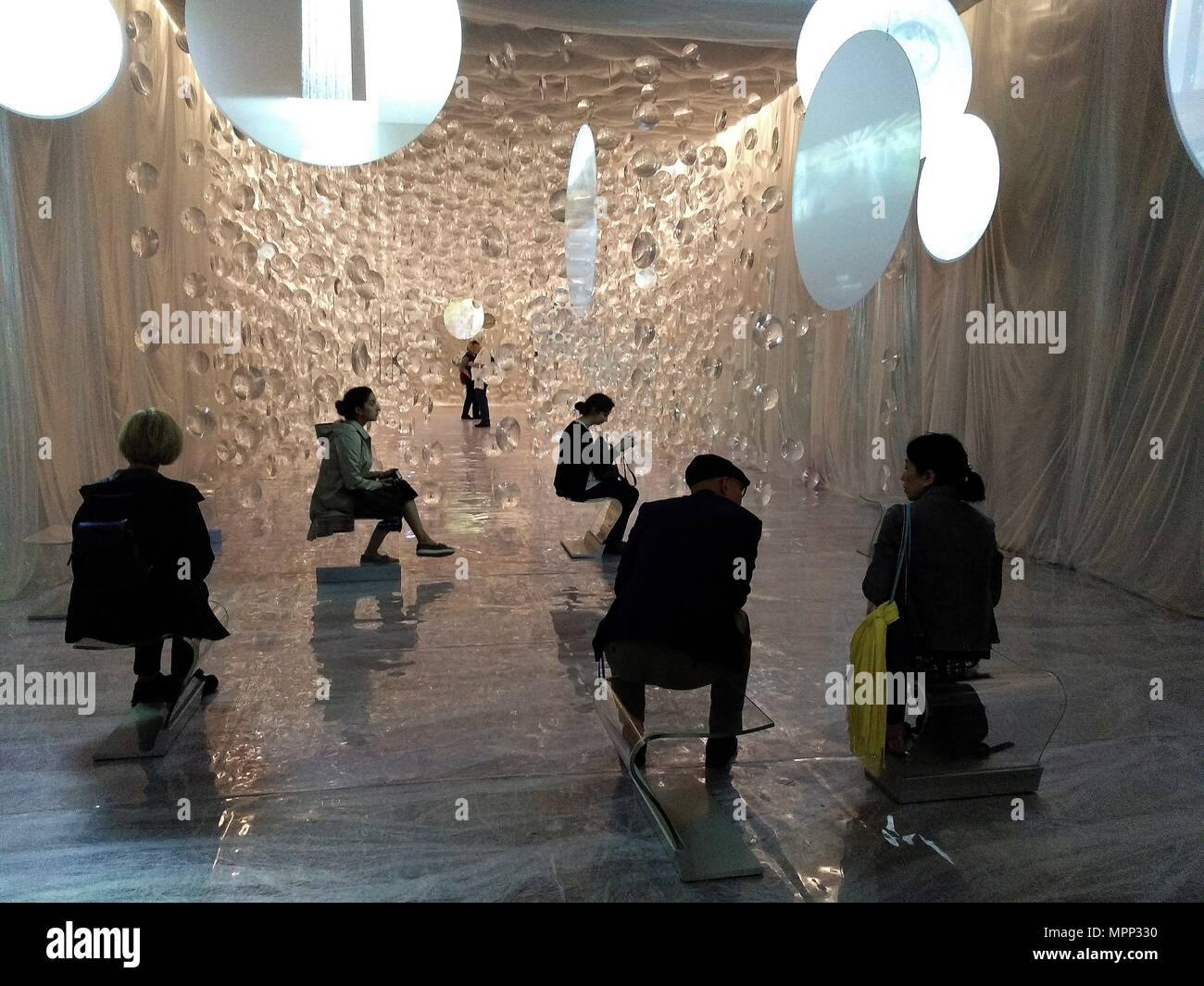 Several people visit the exhibition 'Sueno and Naturaleza