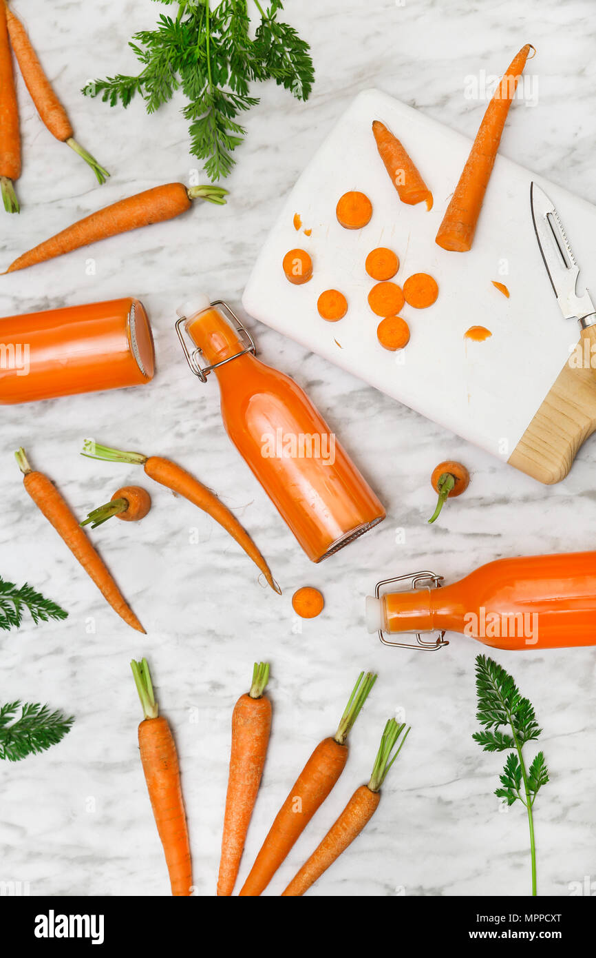 Homemade carrot juice in bottles - Stock Image