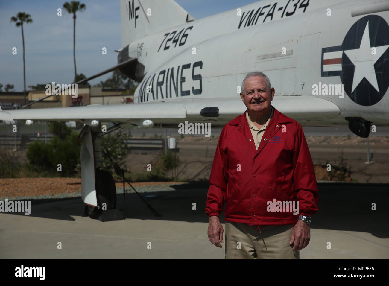 Retired Lt. Col. Jay Bibbler stands in front of a McDonald Douglas F-4S Phantom at The Flying Leatherneck Aviation Museum just outside Marine Corps Air Station Miramar, Calif., April 6. Bibbler flew other versions of the F-4 while supporting combat missions during the Vietnam War. (U.S. Marine Corps photo by Sgt. David Bickel/Released) Stock Photo