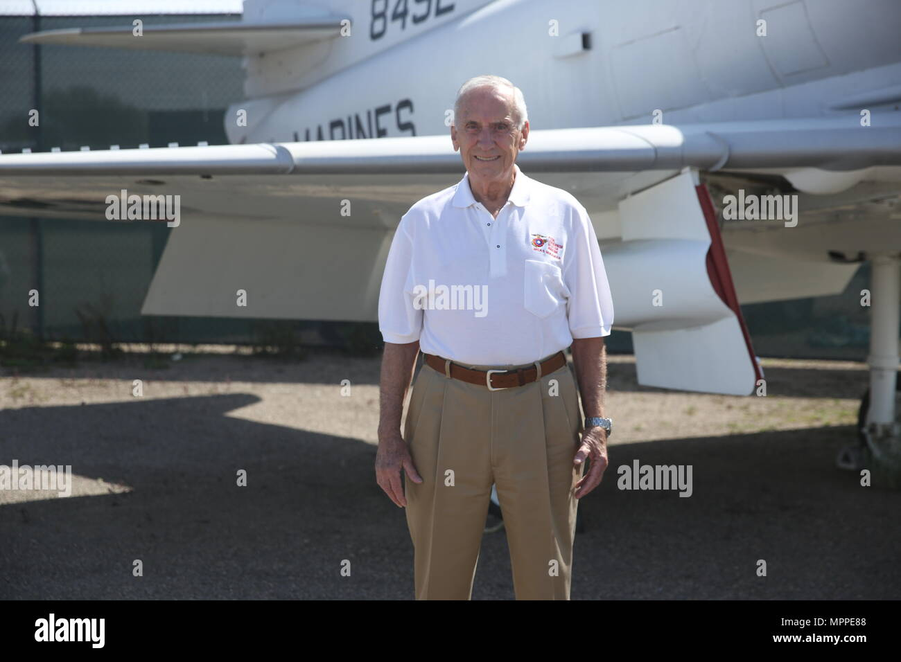 Retired Maj. Gen. Bobby Butcher stands beside a Douglas A-4C Skyhawk at The Flying Leatherneck Aviation Museum just outside Marine Corps Air Station Miramar, Calif., April 6. Butcher flew the Skyhawk towards the end of his tour as a Vietnam pilot. (U.S. Marine Corps photo by Sgt. David Bickel/Released) Stock Photo