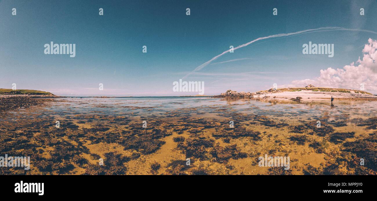 France, Brittany, Landeda, Dunes de Sainte-Marguerite, seascape with woman in background - Stock Image