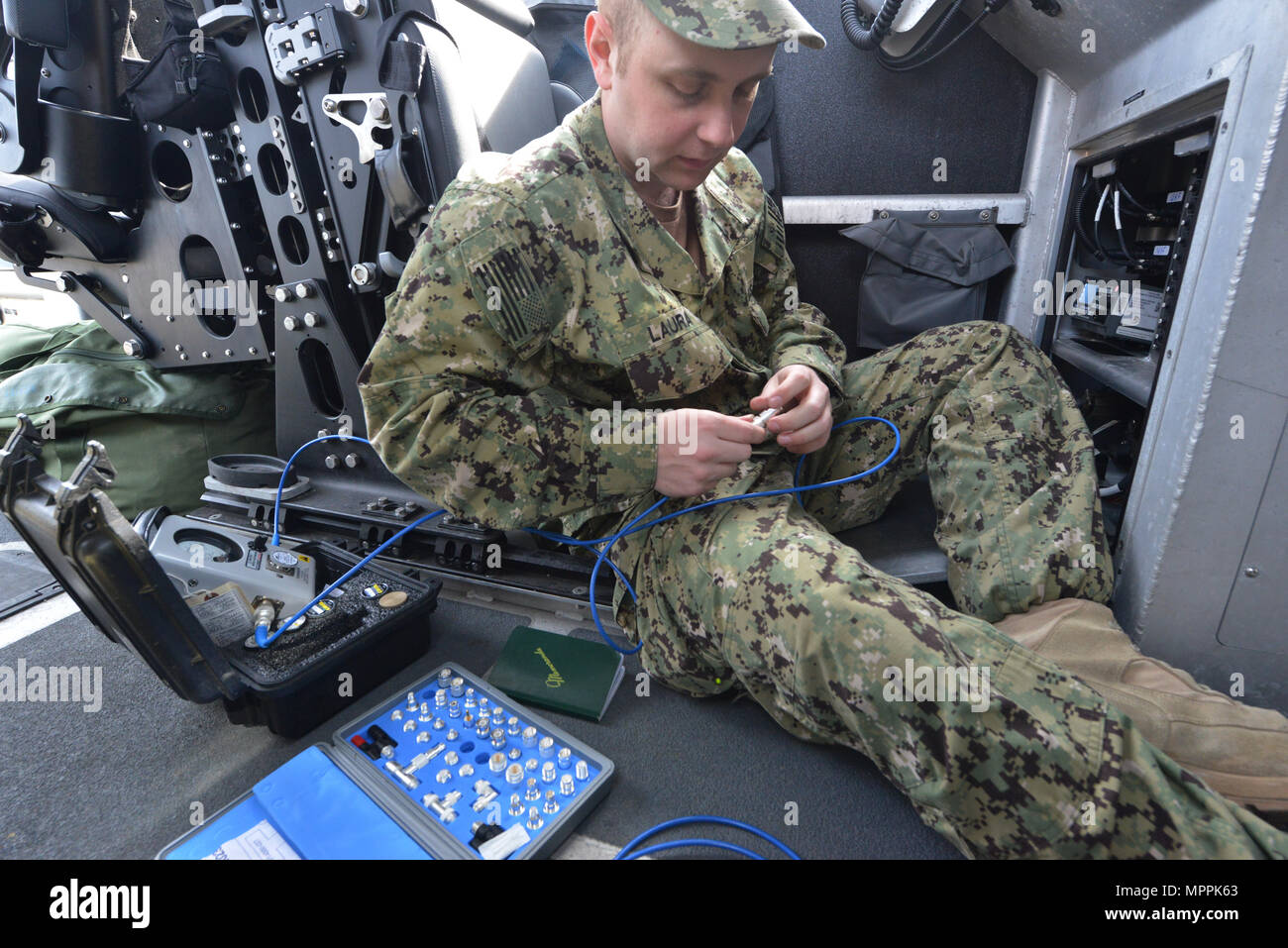 U.S. Coast Guard Caleb Laura, from Coast Guard Port Security 309, performs radio maintenance on a 32-foot Transportable Security Boat  during Operation Pacific Reach Exercise 2017 in Pohang, Republic of Korea, April 8, 2017. OPRex17 is a bilateral training event designed to ensure readiness and sustain the capabilities which strengthen ROK-U.S. Alliance. Coast Guardsmen will serve as part of combined task group conducting ports, waterways and coastal security operations protecting U.S.-ROK assets and personnel exercising an Area Distribution Center (ADC), an Air Terminal Supply Point (ATSP), L Stock Photo