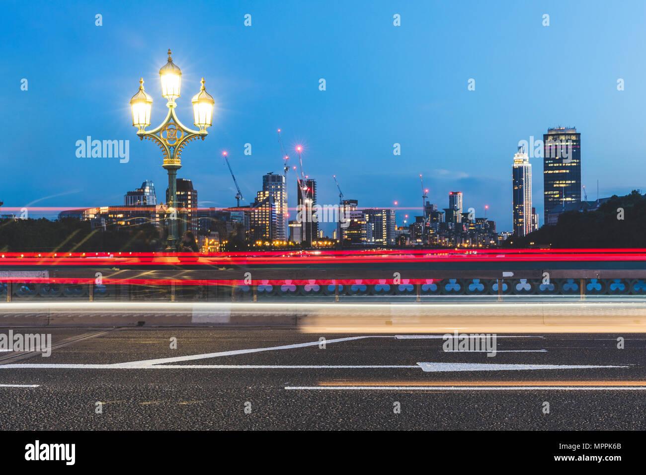 UK, London, traffic light trails on Westminster Bridge at dusk Stock Photo
