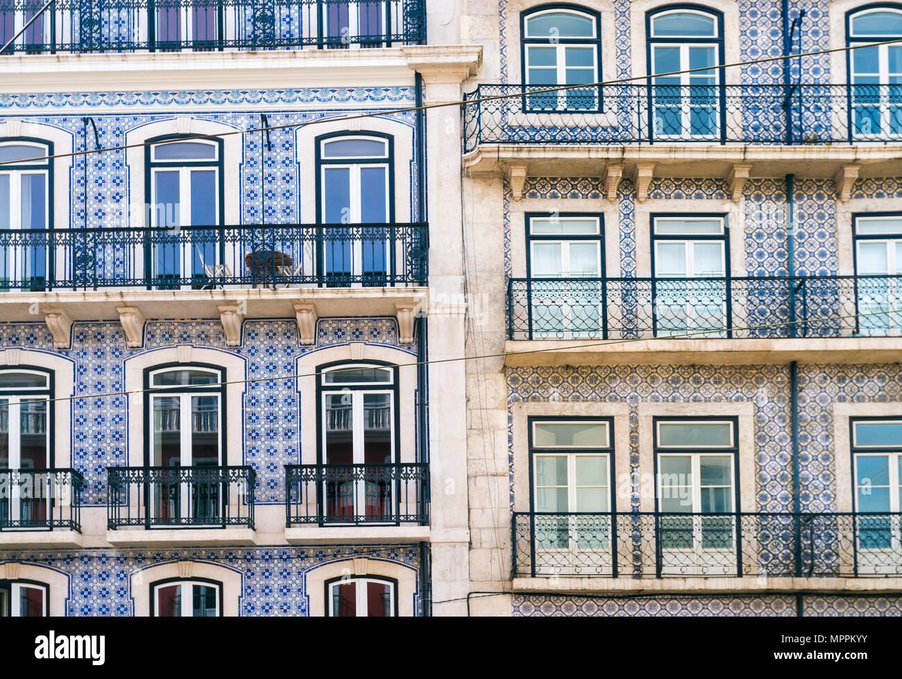 Portugal, Lisbon, facades of two multi-family houses, partial view - Stock Image
