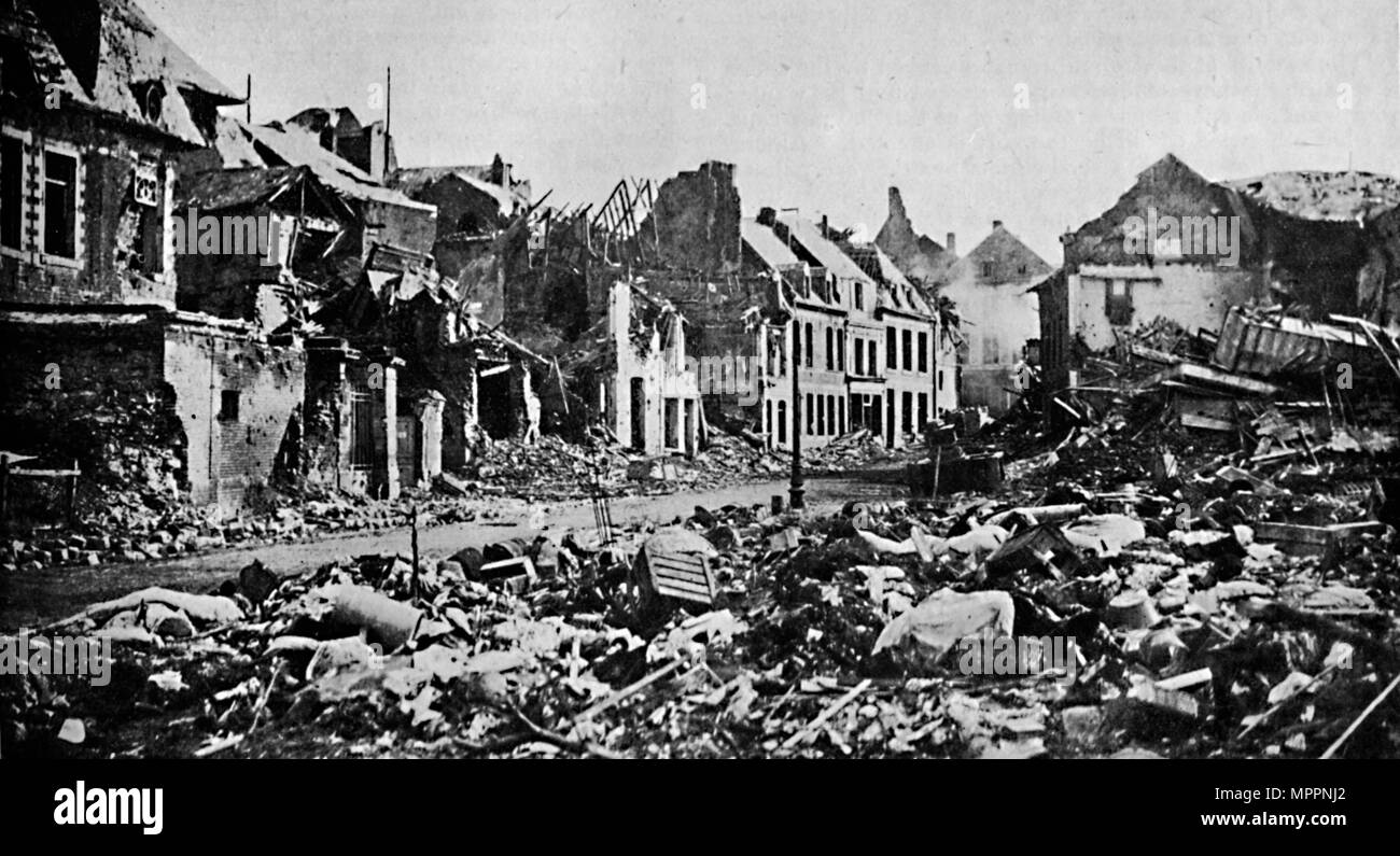 'A Scene of Desolation. -  A Street in Peronne', 1919. Artist: War Office. - Stock Image