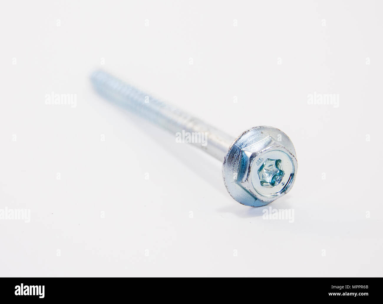 One metal self-tapping screw on white background - Stock Image