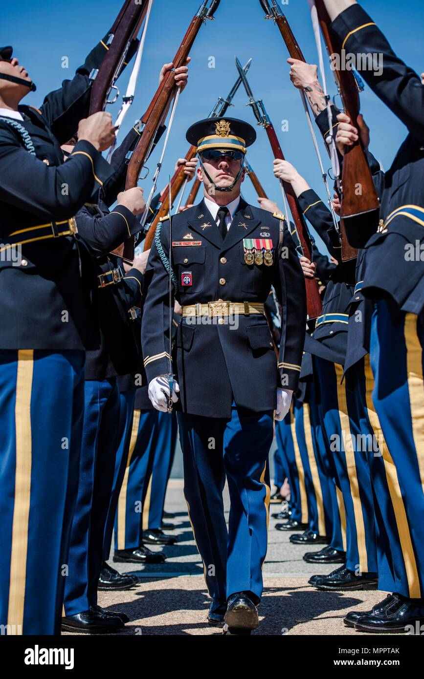 The U.S. Army Drill Team from 3d U.S. Infantry Regiment (The Old Guard), and teams from the other four major military services, came together to perform during the 2017 Joint Service Drill Exhibition at the Jefferson Memorial, Washington, D.C., April 8, 2017. The U.S. Army Drill Team is a precision drill platoon with the primary mission of showcasing the U.S. Army both nationally and internationally through breathtaking routines with bayonet-tipped 1903 Springfield rifles. (U.S. Army photos by Staff Sgt. Terrance D. Rhodes) - Stock Image