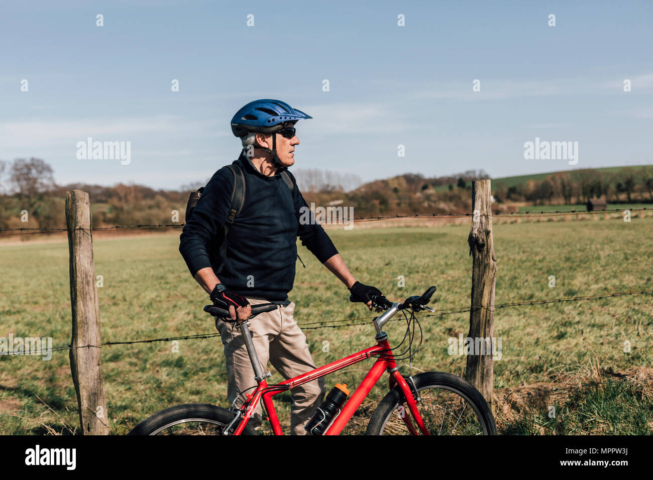 Mountainbiker with cycling helmet - Stock Image