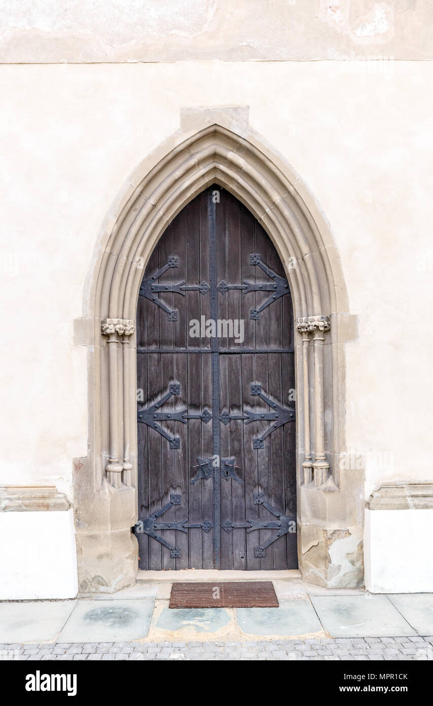 old church or castle front door with iron ornaments stock photo