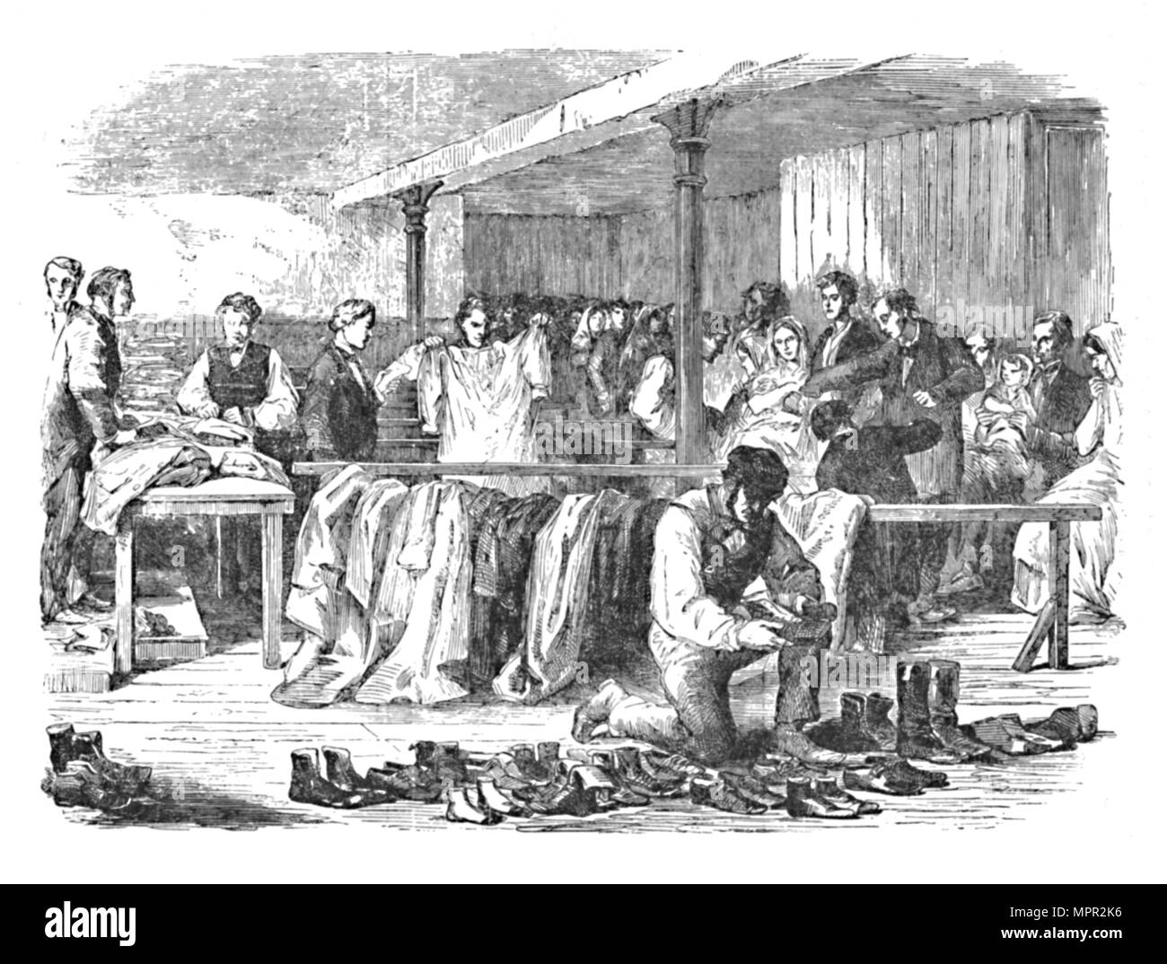 'The Cotton Famine: Distribution of Clothes to Operatives, Manchester', 1904. Artist: Unknown. - Stock Image