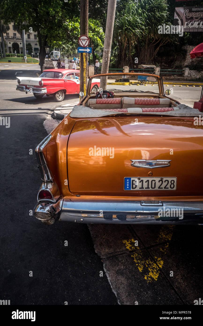 Classic orange gold painted convertible automobile parked outside Hotel Nacional de Cuba, Havana Cuba - Stock Image