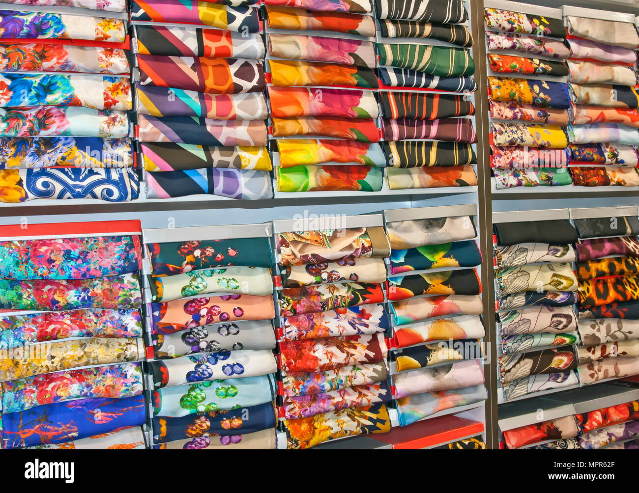 Fabric patterns in textile shop - Stock Image