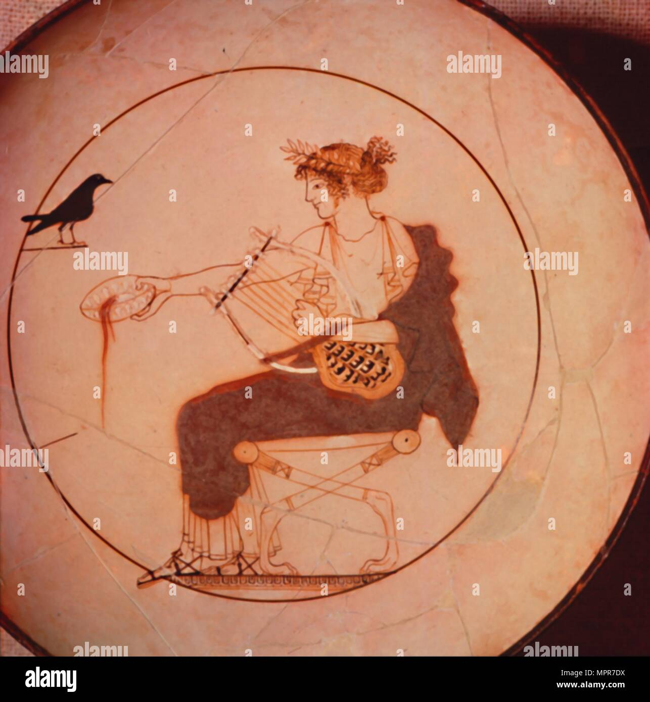Apollo offering a libation to the raven, kylix, 5th century BC. - Stock Image