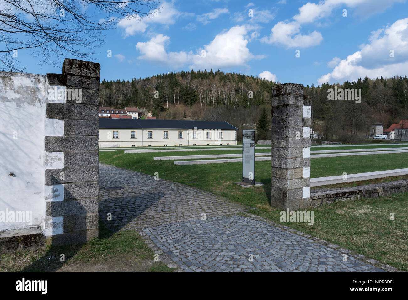View through a camp gate to the former laundry, today exhibition room in the concentration camp memorial Flossenbürg - Stock Image