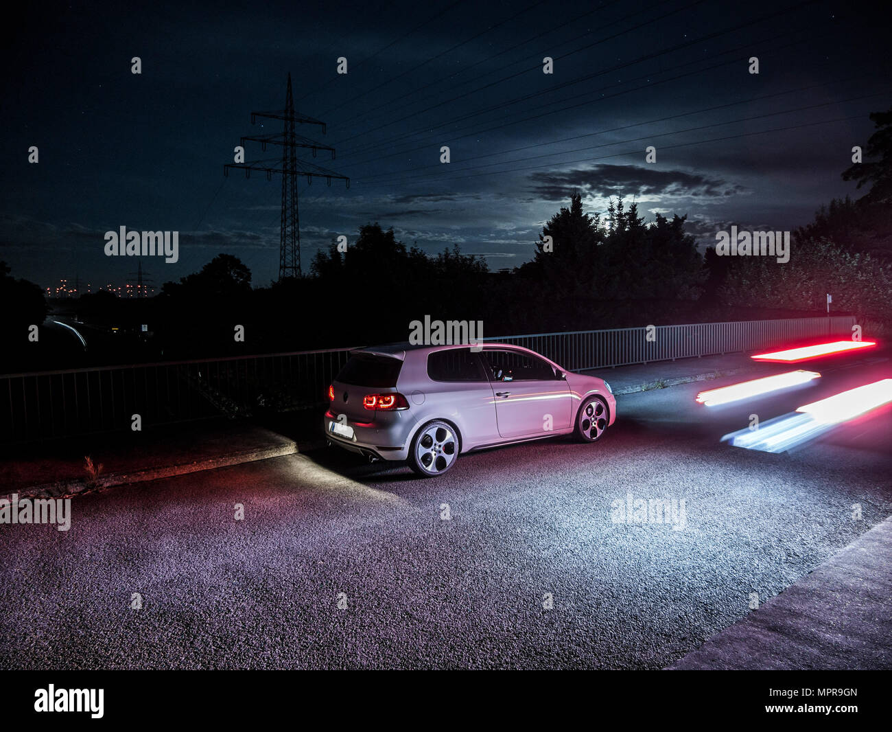 VW Golf 6 GTI on bridge No.4 Stock Photo